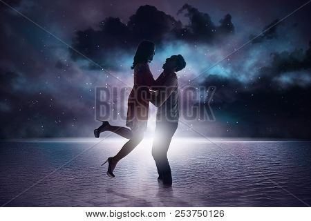 Romantic Asian Couple Smiling Staring At Each Other On The Beach