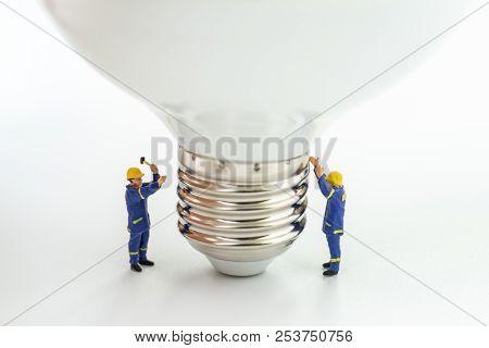 Business Creative Idea, Power Or Energy Generator Concept, Miniature People Figurine Engineer Worker