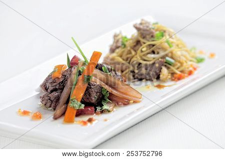 Peruvian Dish Called Lomo Saltado Made Of Tomato, Beef Meat And Onions Mixed With French Fries.