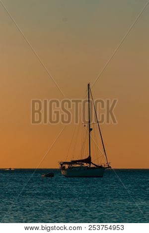 Silhouettes At The Beach During A Beautiful Sunset On A Cloudy Evening Boats And Sea, Sunset Time, S