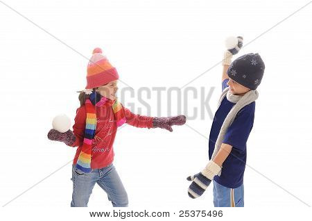 Cute little winter girl and boy snowball fight