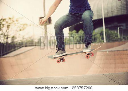 One Young Female Skateboarding On Skatepark Ramp