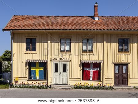 Kristianopel, Sweden On May 14. View Of A Front, Old Local Store, Danish And Swedish Flag On May 14,