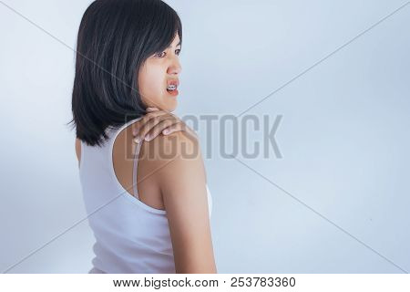 Woman With Pain In The Shoulder,female Hand Touching Her Painful Shoulder Tip On White Blackground
