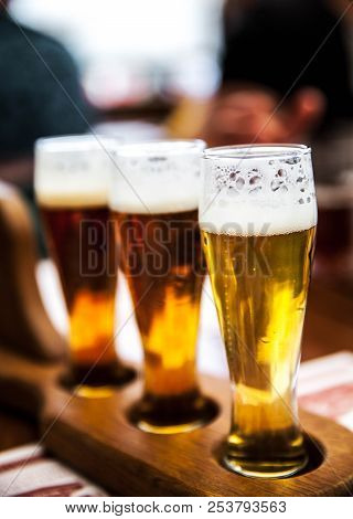 Glass Of Beers On Wooden Table A