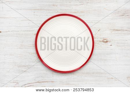 Empty Plate On Vintage Wooden Texture. Top View With Copyspace