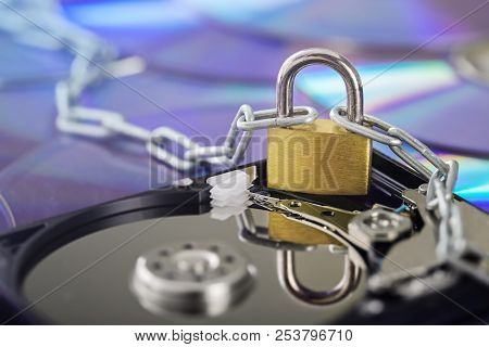 Data Security, Information Protection And Personal Information Defense. Padlock On Hard Drive Disk A