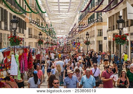 Malaga, Spain - August 12, 2018. People On The Marques De Larios Pedestrian Street At The Feria De M