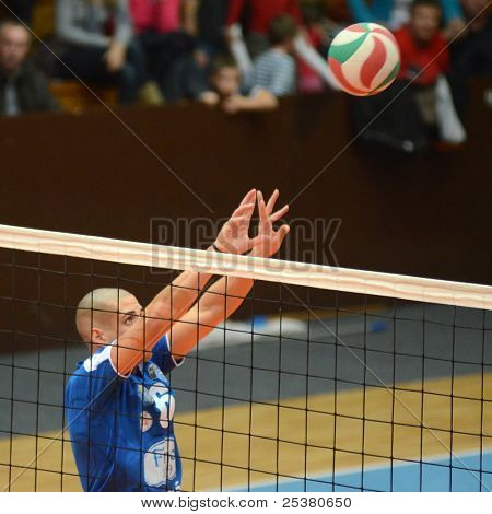 KAPOSVAR, HUNGARY - NOVEMBER 13: Balint Magyar in action at a Hungarian National Championship volleyball game Kaposvar (blue) vs. Nyiregyhaza (red), November 13, 2011 in Kaposvar, Hungary.