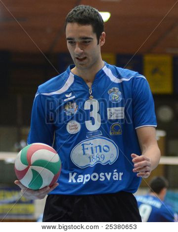 KAPOSVAR, HUNGARY - NOVEMBER 13: Jozsef Nagy in action at a Hungarian National Championship volleyball game Kaposvar (blue) vs. Nyiregyhaza (red), November 13, 2011 in Kaposvar, Hungary.