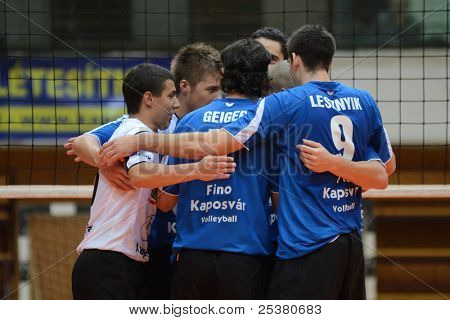 KAPOSVAR, HUNGARY - NOVEMBER 13: Kaposvar players celebrate at a Hungarian National Championship volleyball game Kaposvar (blue) vs. Nyiregyhaza (red), November 13, 2011 in Kaposvar, Hungary.