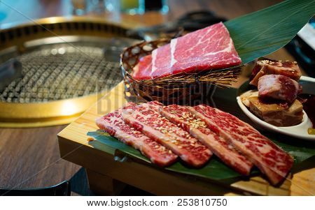 Yakiniku Japanese Barbecue With Raw Beef Meat Dish On The Side