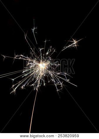 An image of a typical sparkler with dark background