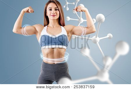 Athletic fitness woman standing near white molecule chain. Good metabolism concept. poster