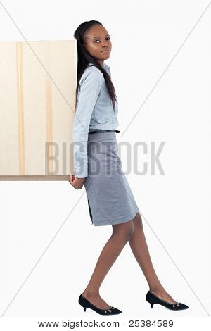 Portrait of a businesswoman pushing a panel with her back against a white background