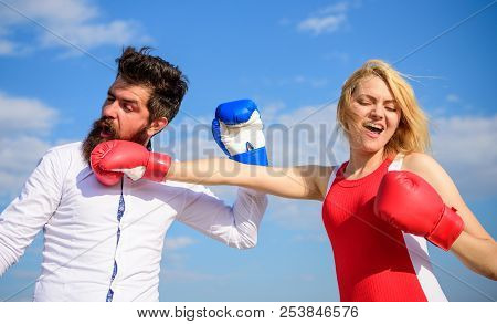 Couple In Love Fighting. Relations As Struggle Concept. Man And Woman Fight Boxing Gloves Blue Sky B