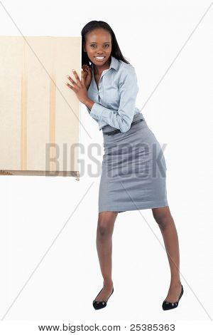 Portrait of a businesswoman pushing a panel against a white background