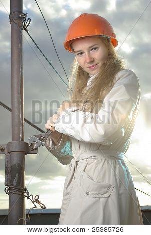 Smiling girl in an orange helmet