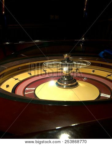 Golden Casino Roulette, Poker Game, Dice Game, Poker Chips On A Gaming Table.