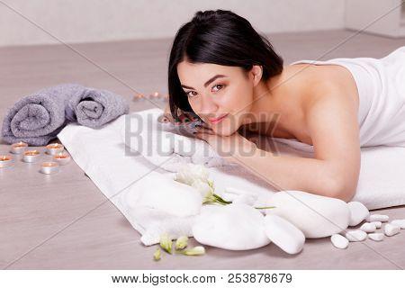 The Process Of Massage.young Woman Enjoying Massage In Spa Salon