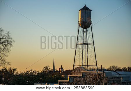 Blue To Gold Colorful Skies In The Sky Water Tower In Round Rock Texas At Sunset