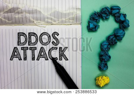 Conceptual hand writing showing Ddos Attack. Business photo text perpetrator seeks to make network resource unavailable Notebook marker crumpled papers question mark on green background. poster