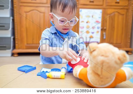 Cute Little Asian 2 Years Old Toddler Baby Boy Child Playing Doctor With Plush Toy At Home, Kid Hold
