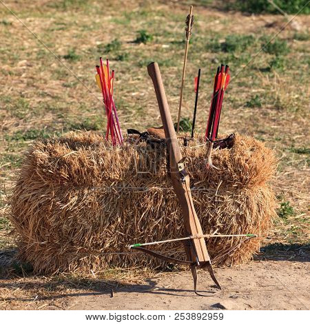 Crossbow and arrows on the straw block