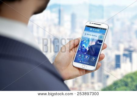 Business Man With Smartphone And Home Banking App On The Screen. Bank Mobile On A Cell Phone, Applic
