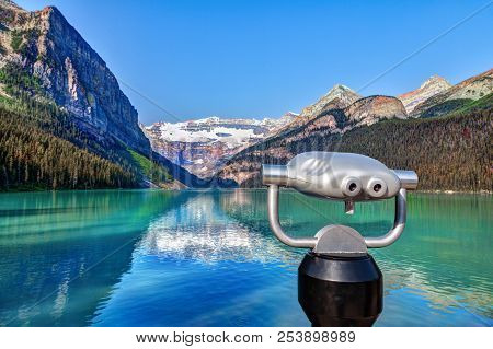Focus On A Tower Viewer Or Binoculars At Lake Louise In Banff National Park With Its Glacier-fed Tur