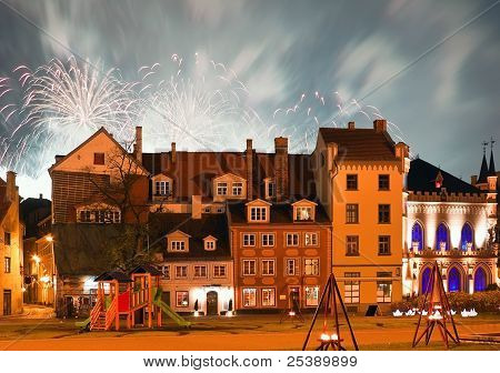 Livu square in the center of Riga city with fireworks on night sky poster