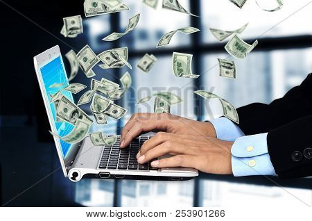 Businessman Making Money On Internet With His Laptop