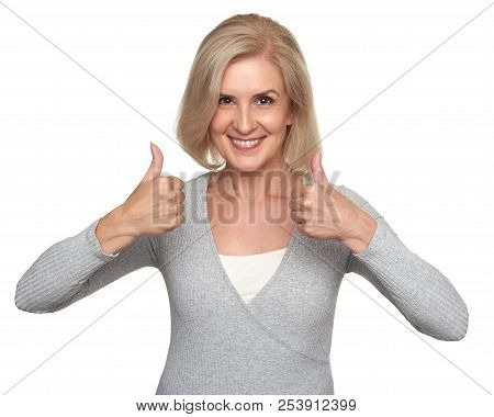 Senior Woman Showing Thumbs Up And Toothy Smiling