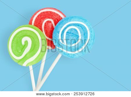 Colorful Lolli Pop. Lollipop On Blue Background With Clipping Path