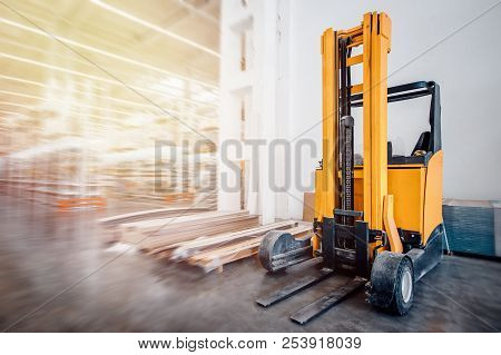 Warehouse Industrial Premises For Storing Materials And Wood, There Is Forklift Containers. Concept
