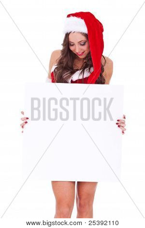 Santa Woman Looking At A Blank Board