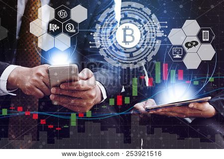 Bitcoin And Cryptocurrency Investing Concept - Businessman Using Mobile Phone Application To Trade B