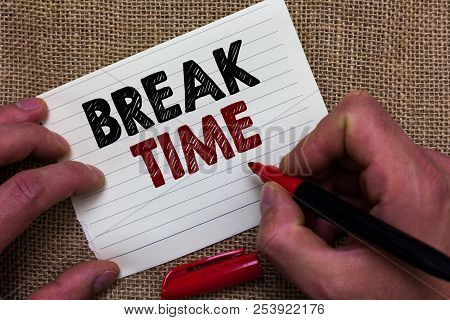 Writing note showing Break Time. Business photo showcasing Period of rest or recreation after doing of certain work Man's hand hold white paper with symbolic letter jute sack background poster