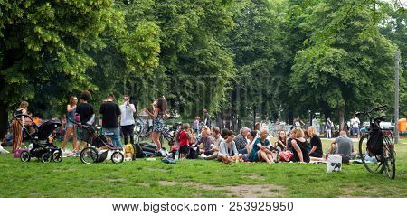 BERLIN, GERMANY - MAY 25, 2018: People enjoying at the Monbijou Park in Berlin, Germany, a popular public park in the Mitte district