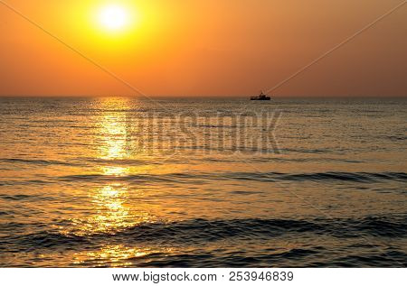 Amazing Sea Sunset. Sunset Sea Waves. Summer Sunset. Beautiful Seascape Evening Sunset Sea And Ship.