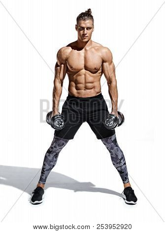 Sporty Guy Holding Dumbbells. Photo Of Young Guy With Good Physique Isolated On White Background. St