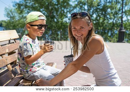 Happy Smiling Mother And Child - Boy - Enjoying Meal Time In Street Cafe, Restaurant, Family Time, L