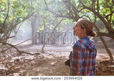 In The Misty Morning Happy Girl With Photo Camera Walk Alone By Jungle Path, Explore Tropical Rain F