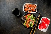Asian trendy food, sushi poke bowl with cucumber, salmon, avocado, Black and White Sesame Seeds poster