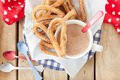 Yummy deep fried churros with cinnamon and sugar poster