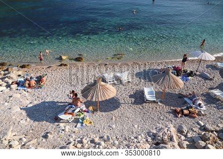 Korcula, Croatia - June 25, 2019: People Spend Vacation At Pupnatska Luka Beach In Korcula Island Of