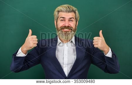 Super Teacher. Happy Man Give Thumbs Ups At Chalkboard. Senior Professor Smile Gesturing Thumbs Ups.