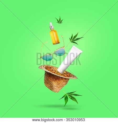 Cbd Oil And Cosmetics With Leaf Of Marijuana Glasses And A Hat Flying In Antigravity. Summer Cannabi