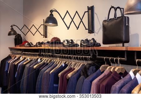 Closeup Colorful Male, Female Clothes, Shoes In Boutique Hanging On Hangers, Clothing Rack. Concept