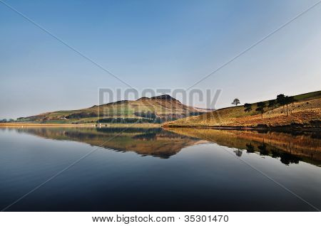 reflection of dovestone on a clear sunny day
